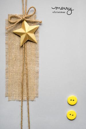 estrella de la vida: Creative concept of christmas decorations with sign on grey background.