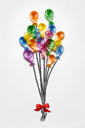 Creative concept photo of balloons made of paper on white background.