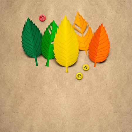 Creative thanksgiving day concept photo of leaves made of paper on brown background. Stock Photo