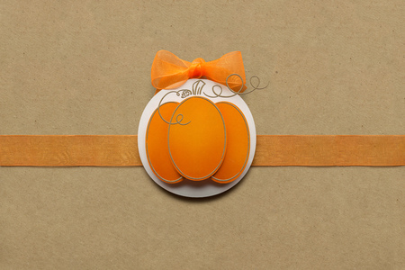 Creative thanksgiving day concept photo of pumpkin made of paper on brown background. Stok Fotoğraf