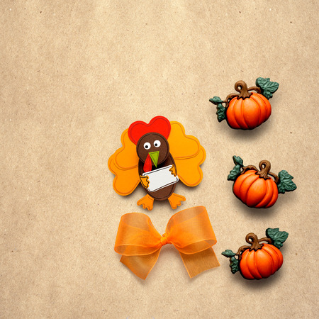Creative thanksgiving day concept photo of a turkey made of paper on brown background. Stock Photo