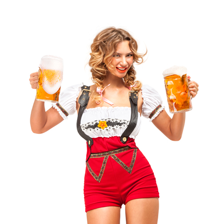 Creative concept photo of Oktoberfest waitress wearing a traditional Bavarian costume with beer isolated on white background.