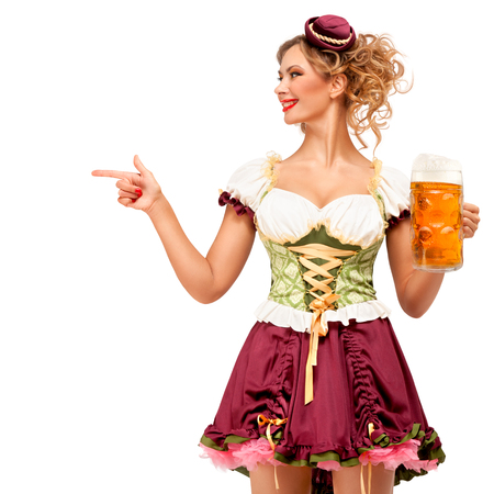 Creative concept photo of Oktoberfest waitress wearing a traditional Bavarian costume with beer isolated on white background. Standard-Bild - 108418091