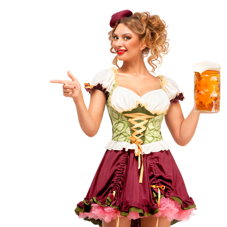 Creative concept photo of Oktoberfest waitress wearing a traditional Bavarian costume with beer isolated on white background. Standard-Bild - 108418095