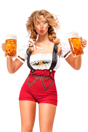 Creative concept photo of Oktoberfest waitress wearing a traditional Bavarian costume with beer isolated on white background. Standard-Bild - 108418102