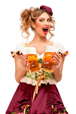 Creative concept photo of Oktoberfest waitress wearing a traditional Bavarian costume with beer isolated on white background. Standard-Bild - 108418119