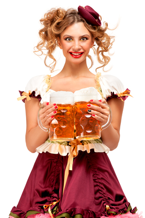 Creative concept photo of Oktoberfest waitress wearing a traditional Bavarian costume with beer isolated on white background. Standard-Bild - 108462184