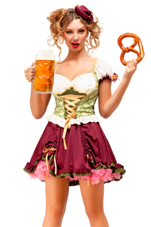 Creative concept photo of Oktoberfest waitress wearing a traditional Bavarian costume with beer and pretzel isolated on white background. Standard-Bild - 108462199