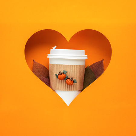 Creative thanksgiving day concept photo of take away coffee cup on orange background.