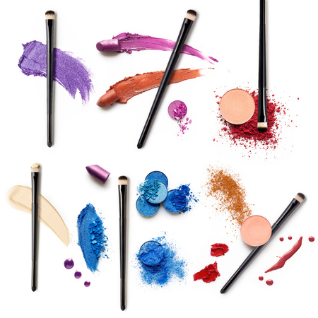 Creative concept photo set of cosmetic swatches with brushes lipstick eyeshadow and other beauty products on white background.