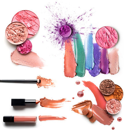 Creative concept photo set of cosmetic swatches with lipstick eyeshadow and other beauty products on white background.
