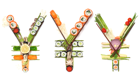 Creative concept photo set of yen sing currency made of sushi and vegetables on white background. A still life of yen sign made of sushi.