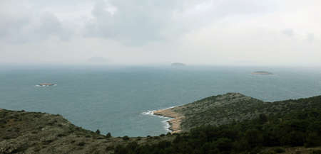 Cloudy weather on sea and islands in the distance  photo