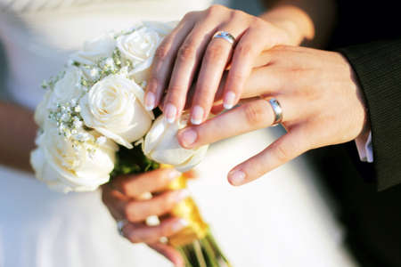 wedding ring hands: Wedding rings, bouqet and hands holding Stock Photo