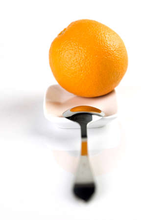 orange with spoon on the plate