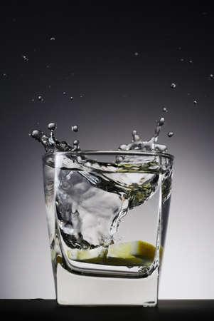 lemon slice splash in the glass of water Stock Photo