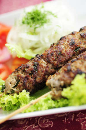 Asian meal kebab with lettuce