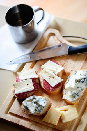 Sandwiches with gorgonzola, brie and salami