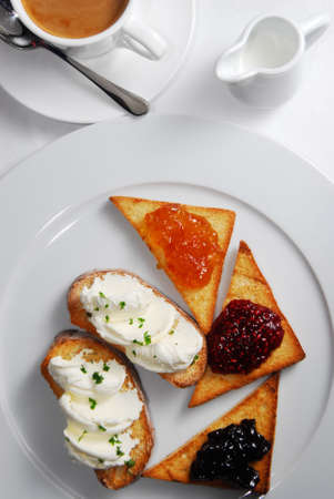 The breakfast with toasts and coffee