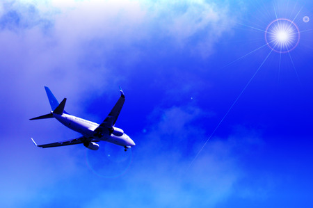 corporate airplane: Jet plane with shiny blue sky image background