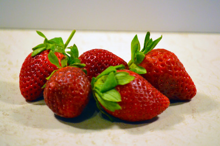close up food: Strawberries on white table background