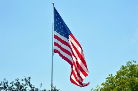 flagged: USA flag against vivid blue sky background picture