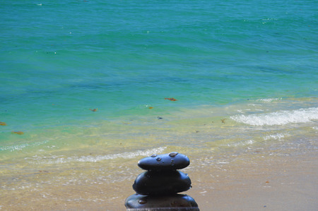 Beach with zen stones in harmony nature balance vivid colors photo