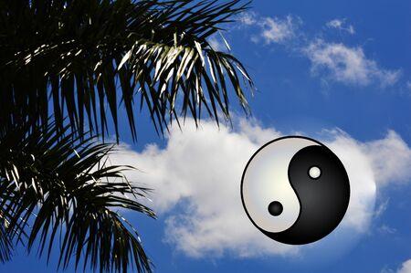 Yin Yang symbol of harmony on blue vivid sky  photo