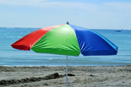 stock photograph: Beach and colored umbrella