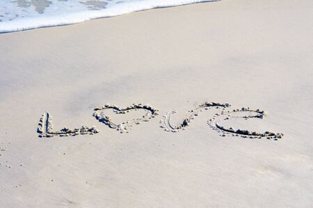 greeting season: Love written on beach picture Stock Photo