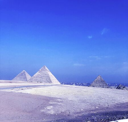 The Pyramids of Gizeh near Cairo in Egypt with a blue sunny sky image picture