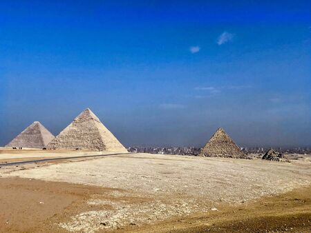 The Pyramids of Gizeh near Cairo in Egypt with a blue sunny sky image picture 版權商用圖片 - 129485251