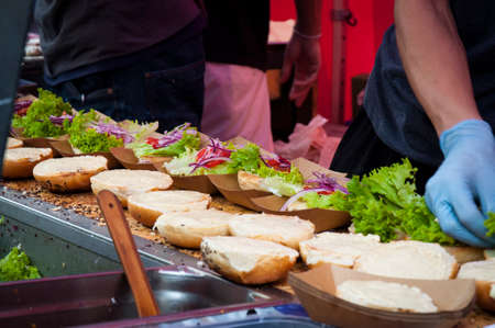 preparing hamburgers on the street Фото со стока