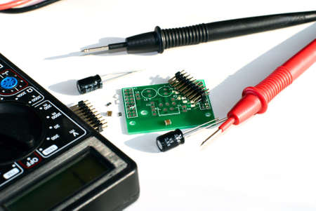 Images of the device for testing of payments and a payment. Mainly white background. Electronic components Stock Photo - 6495664