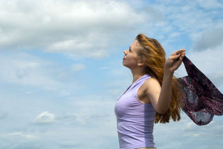 Young beautiful woman celebrates the freedom of nature.