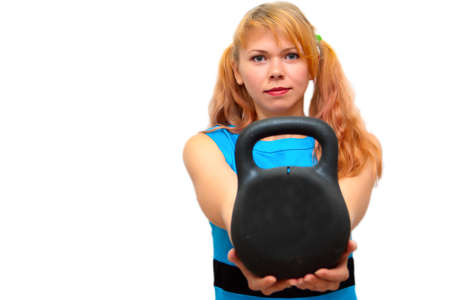 Beautiful girl suggests to take from it the heavy dumbbell photo