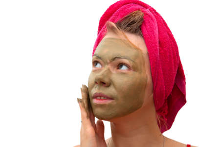 Portrait of young woman with cosmetic mask on her face photo
