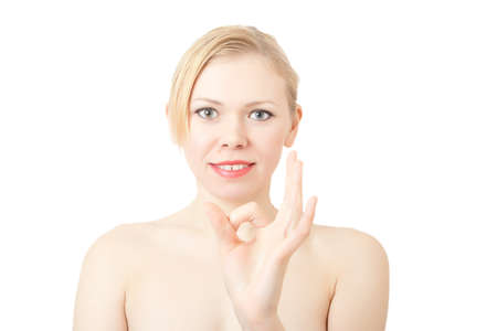 Happy lucky young woman with ok gesture on a white background