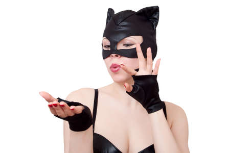 woman in cat costume  looks at her open palm photo