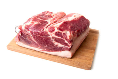 Big piece  meat on a kitchen board on a white background Stock Photo