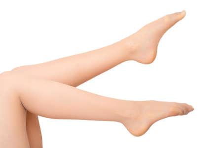 Beautiful woman legs on a white background photo