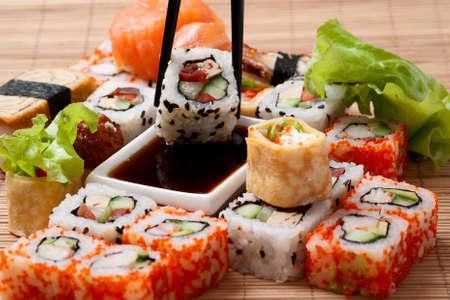 japanese foods: Traditional Japanese food Sushi. Closeup japanese sushi on a bamboo napkin. Sushi collection