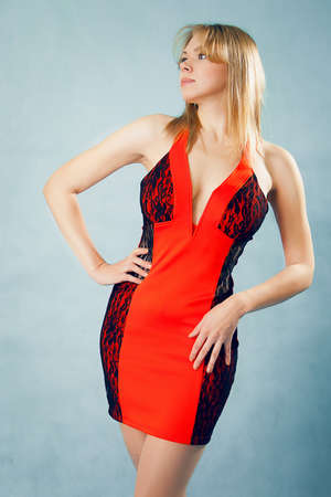 Glamour proud woman in red dress