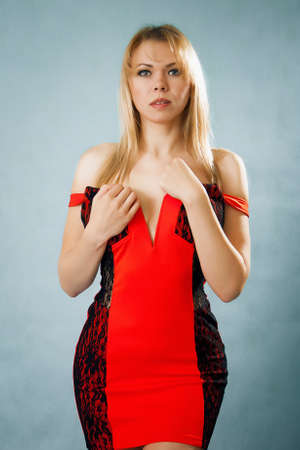 Erotic woman in red dress