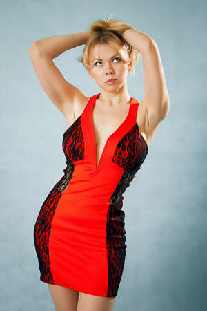 Sexy blond lady in red dress