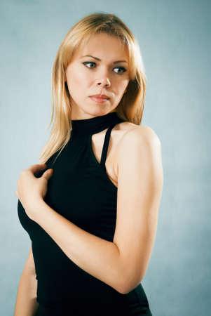 Thinking beautiful woman in black dress Stock Photo