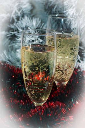glass sphere: Two glasses of champagne with reflection,on color tinsel for background Stock Photo