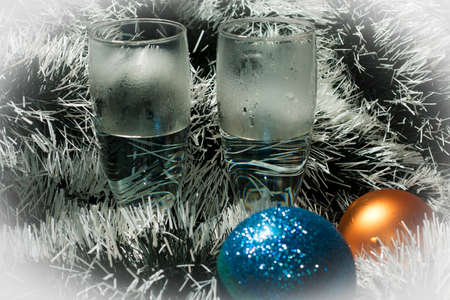 candlelit: Snow silver tinsel and  champagne Stock Photo