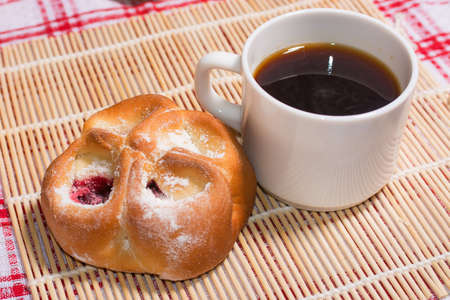 red tablecloth: Tasty pies with cup of coffee on red tablecloth Stock Photo