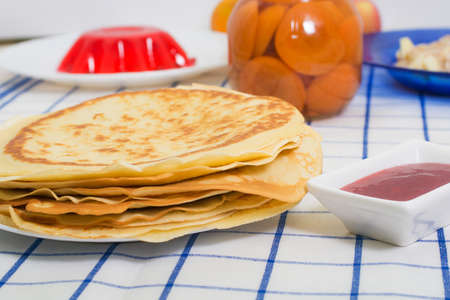 flapjacks: Tasty pancakes with fruits on back background